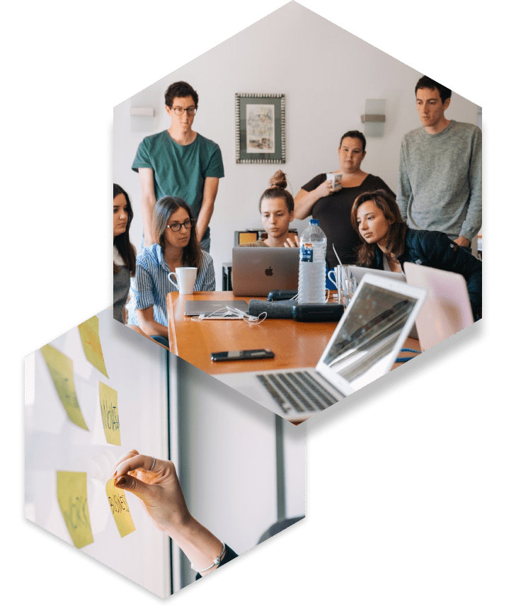 employees in work team meeting with laptops and notes