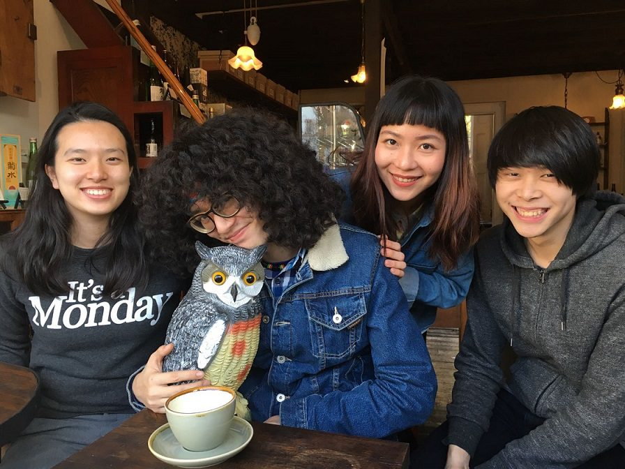 Four teenagers in coffee shop