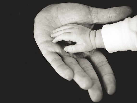 Hands of father and baby