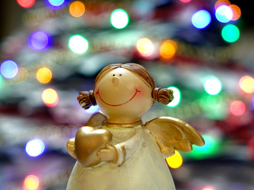 toy angel holding a heart