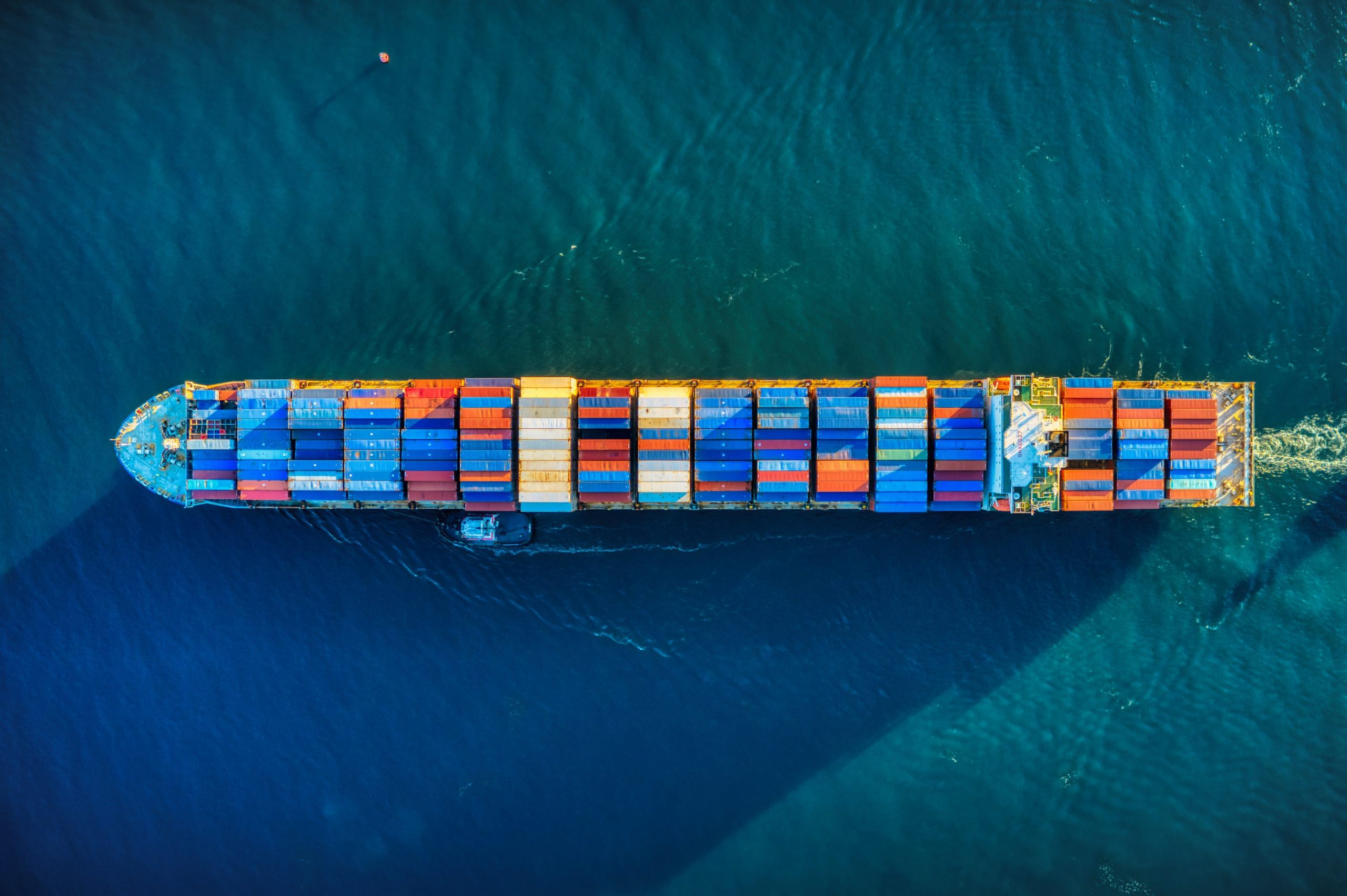 A birdseye view of a cargo ship filled with shipping containers